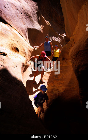 Family hiking in a slot canyon, Canyonlands National Park, Utah - Stock Photo