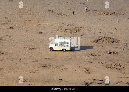Ice cream van on an almost deserted West Cliff beach, Whitby, North Yorkshire, England, UK. - Stock Photo