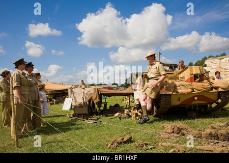 WWII reenactors at the War & Peace Show with a tank. - Stock Photo