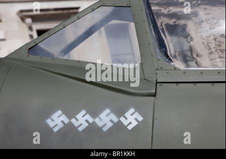 German Swastikas 'score' on replica WW2 RAF Spitfire, London - Stock Photo