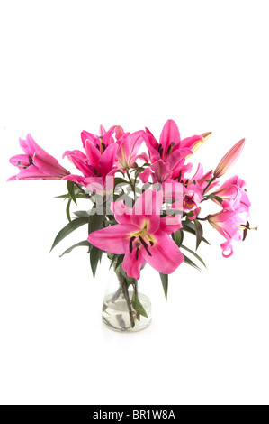 Bouquet pink Lily flowers in glas vase - Stock Photo