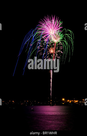 Fireworks display on Fourth of July at beach - Stock Photo