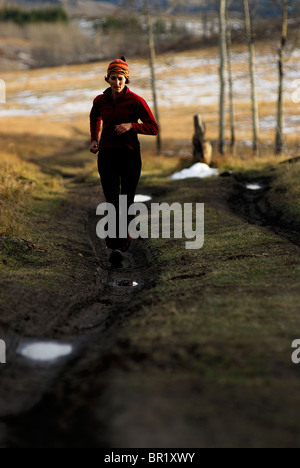 Woman trail running in Jackson, Wyoming, USA - Stock Photo