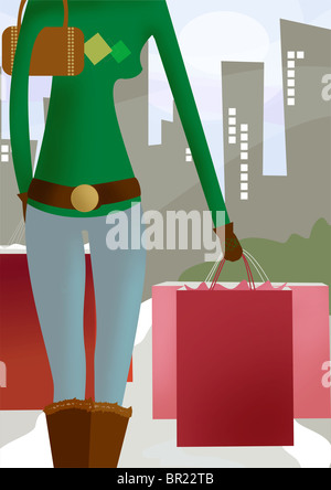 A woman on her winter shopping spree - Stock Photo