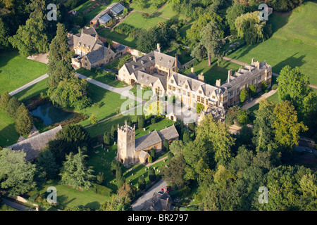 An aerial view of Stanway House and St Peters church in the Cotswold village of Stanway, Gloucestershire from the - Stock Photo