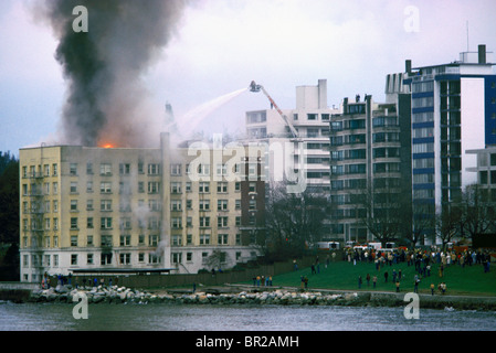 Firefighters / Firemen fighting Blazing Fire in Burning Building, Vancouver, BC, British Columbia, Canada - Stock Photo