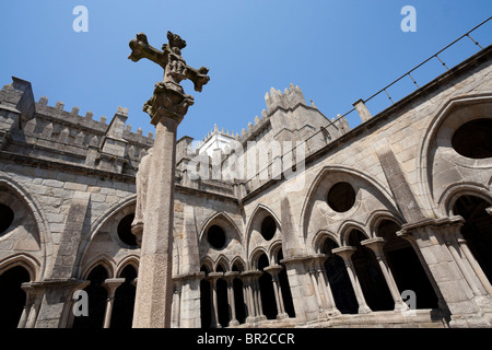 A cross in the gothic cloister of the Oporto Cathedral (Sé do Porto), Portugal - Stock Photo