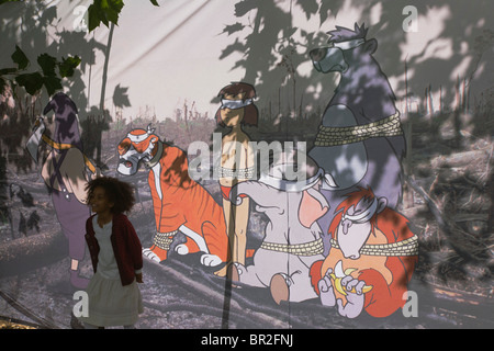 Backdrop of Banksy / Disney Jungle Book characters to illustrate de-forestation & loss of animal habitats due to - Stock Photo