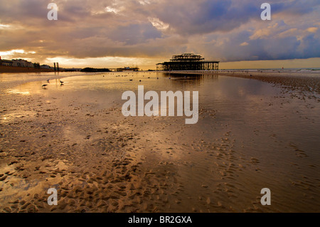 Hove beach and the view towards Brighton and the derelict West Pier at low tide, Brighton and Hove, East Sussex, - Stock Photo