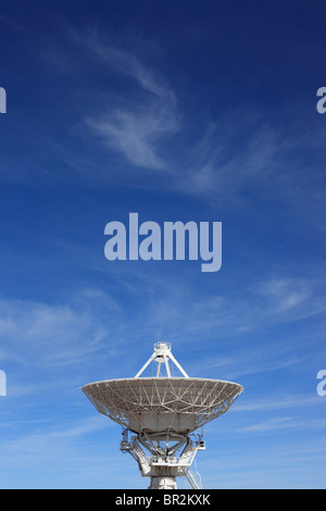 A radio telescope dish in the Very Large Array, New Mexico, is pointed skyward. - Stock Photo