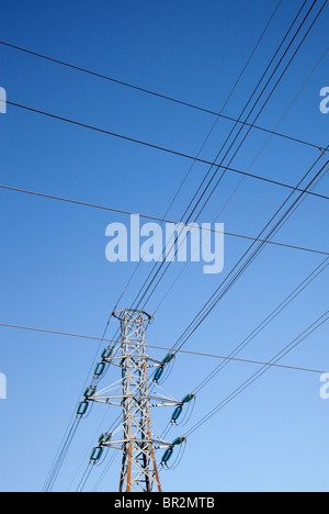 High-voltage power lines and metallic pylon - Stock Photo