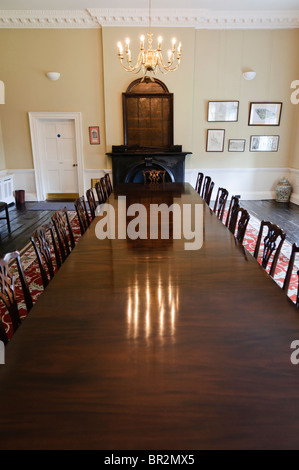 Old fashioned wooden chairs by table stock photo royalty for Old fashioned dining room tables