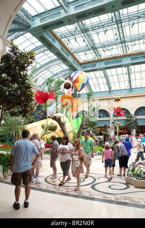 People enjoying the conservatory and botanical gardens, the Bellagio Hotel, Las Vegas USA - Stock Photo