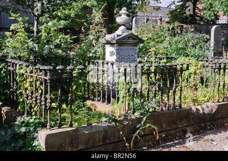Old graveyard with cast iron mortsafe, used to prevent body snatchers during the early 1800s. - Stock Photo