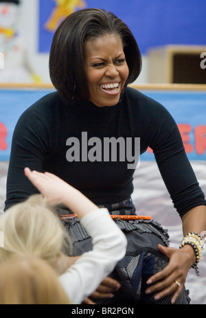 First Lady Michelle Obama reads to children at the Dept. of Labor daycare center. - Stock Photo