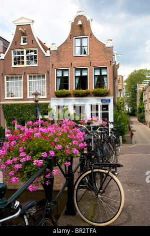 typical small dutch houses in the Jordaan quarter in Amsterdam - Stock Photo
