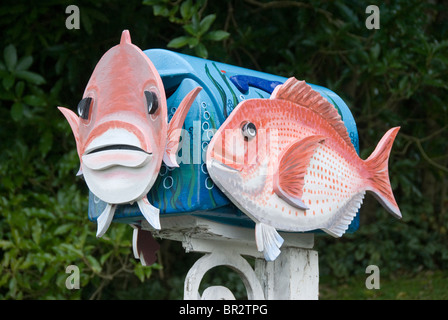 Mail box is shape of snapper fish, Linkwater, Marlborough, South Island, New Zealand - Stock Photo