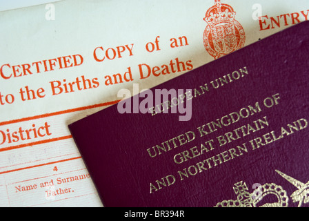 UK Birth Certificate and Passport - Stock Photo
