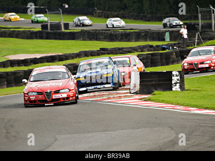 Alfasport Alfa Romeo 156 WTC Leads a String Of Alfas Through Brittens at Oulton Park Motor Racing Circuit Cheshire - Stock Photo