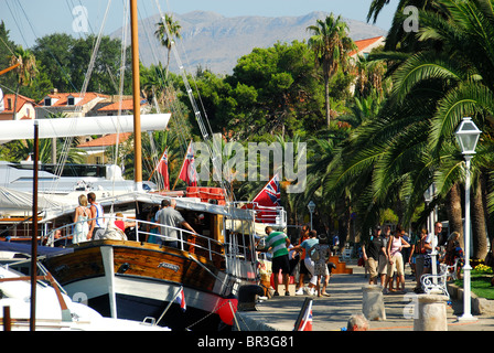 CAVTAT, near DUBROVNIK, CROATIA. A view of the harbour, with tourists arriving by boat from Dubrovnik. - Stock Photo