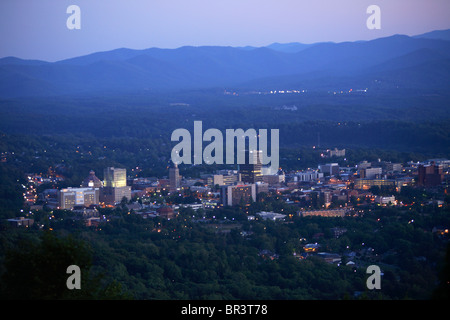 Twilight view of the heart of downtown Asheville, NC as seen from town mountain. - Stock Photo