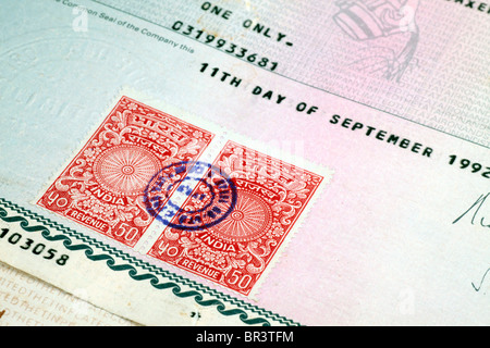 Share certificates in MATERIAL (paper stationery) form, as against the DEMATERIALIZED (DEMAT) certificates available - Stock Photo