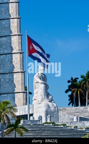 Cuban flag and statue in center of town of Jose Marti, Havana, Cuba - Stock Photo