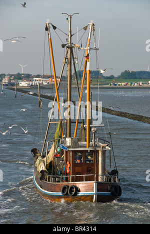 Fishing boat returning to Langeoog, Germany - Stock Photo