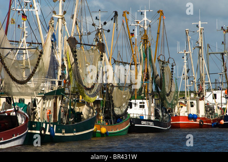 Shrimp boats in Greetsiel harbour, Germany - Stock Photo