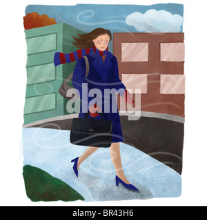 A businesswoman walking on a cold winter day - Stock Photo