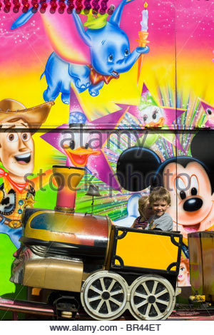 Cartoon Character on a fairground ride - Stock Photo