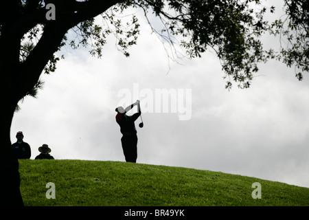A golfer hits golf ball, La Jolla, California.