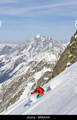 A man skis untracked powder off-piste at Stubai Ski Resort, near Innsbruck, Austria. - Stock Photo