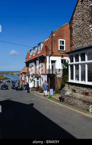 The High Street in Blakeney, Norfolk, looking towards the coast and salt marshes - Stock Photo