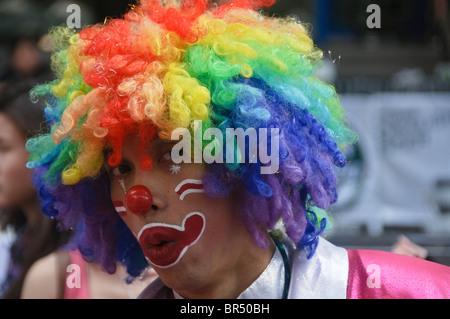 clown performing at the Silom Street Festival in Bangkok Thailand - Stock Photo