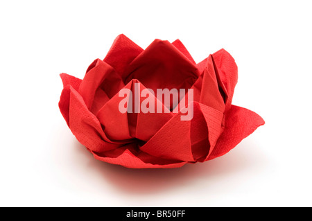 Red lotus origami on a white background - Stock Photo