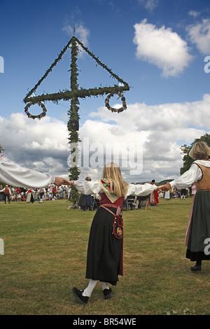 Ring dance around maypole. - Stock Photo