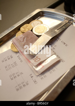 Paying the bill at a French grand cafe in Dijon, Burgundy, France - Stock Photo