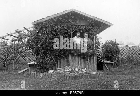 Historic photograph, two women in their garden house, around 1931 - Stock Photo