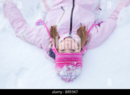 Girl Wearing Pink Woolly Hat in the Snow - Stock Photo