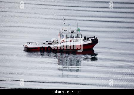 Icelandic pilot boat Sleipnir guiding a cruise ship into port in Akureyri - Stock Photo