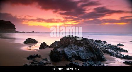 Sunset on empty beach Fuerteventura Canary Islands Spain - Stock Photo