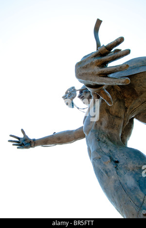 'The Chase' cast stainless steel sculpture in front of the Barber Vintage Motorsports Museum in Birmingham, Alabama, - Stock Photo