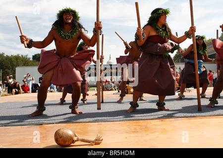Members of the Hawaiian Halau O Kekuhi dance company perform at the First Americans Festival on the National Mall, - Stock Photo