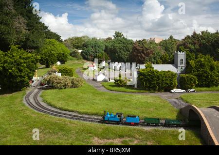 UK, England, Merseyside, Southport, train running through Model Railway Village - Stock Photo