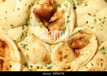 Home made Naan Bread Traditionally Indian Cuisine - Stock Photo