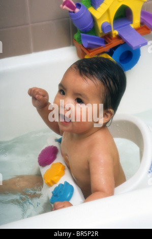 hispanic baby bath tub wash play water soap safe protect guard smile stock photo royalty free. Black Bedroom Furniture Sets. Home Design Ideas
