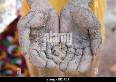 A farm worker shows his hands after working in the fields all day. - Stock Photo