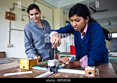 A teenage girl in an electrical class at the Jyoti Vocational Training and Rehabilitation Centre in Nepal. - Stock Photo