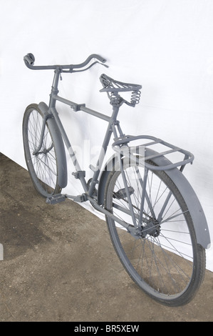 A Luftwaffe paratrooper's bicycle, foldable, restored. Lacking items: leather saddle, toolbox and handlebar handles. - Stock Photo